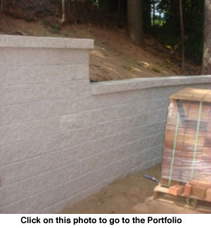 This retaining wall is properly structured so that it will hold back the earth behind it for years to come